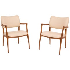 Sculptural Pair of Walnut and Leather Armchairs