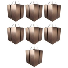 Unique Set of Seven Mid-Century Modern Hanging Brass Chandeliers