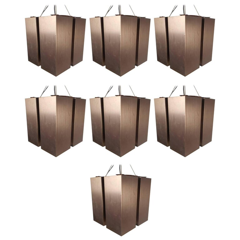 Unique Set of Seven Mid-Century Modern Hanging Brass Chandeliers For Sale