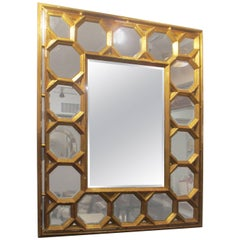 Hand-Carved Giltwood Mirror Featuring Octagonal Design Along Border