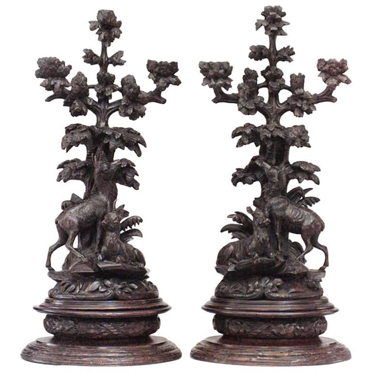Pair of Rustic Black Forest, 19th Century Carved Walnut Three-Arm Candelabra