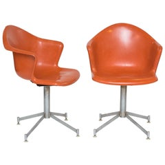 Pair of Orange Mid-Century Modern Fiberglass Shell Swivel Chairs