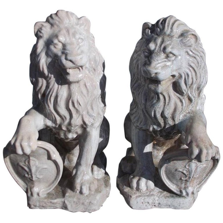Pair of French Glazed Terracotta Lions Grasping Fleur De Lis Plaques, Circa 1840