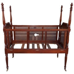 Charleston Mahogany Urn Finial Four-Poster Crib with Caning, Circa 1800