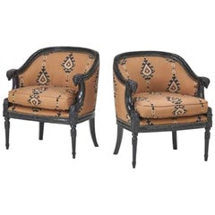 Pair of Bergere chairs with carved ram head arms