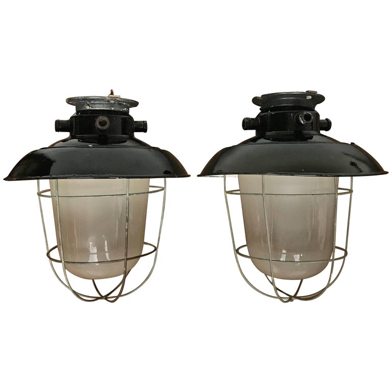 1920s Matching Pair of Industrial, Glass & Black Enamel Caged Light Pendant