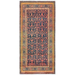 Antique Navy Background Pomegranate Design Khotan Rug
