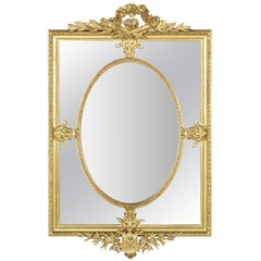 Large 19th Century Louis XVI Style Giltwood and Beveled Mirror with Inset Oval