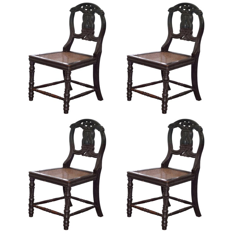 Set of Four 19th Century Ebonized and Carved Wood Chinese Dragon Dining Chairs