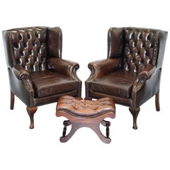 Pair of 1960s Aged Brown Leather Chesterfield Wingback Armchairs and Footstool