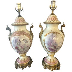 Pair of Bronze Mounted French Porcelain Serves Urns Converted into Table Lamps