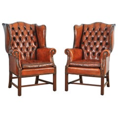 Pair of Mid-20th Century Button Back Leather Wing Chairs