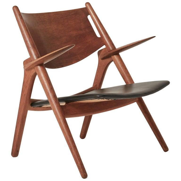 Hans Wegner CH28 Sawbuck Armchair, 1950s, Denmark
