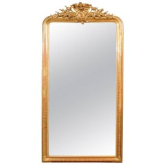 French Rococo Style Tall Giltwood Mirror with Carved Crest from the 1880s