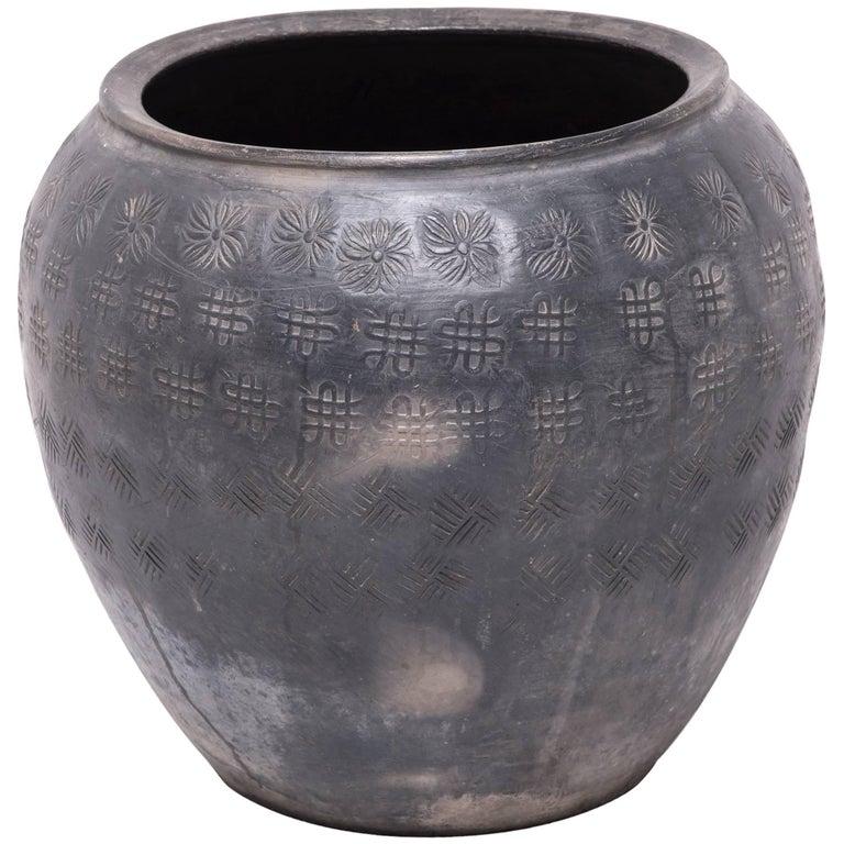 Chinese Unglazed Stamped Clay Jar