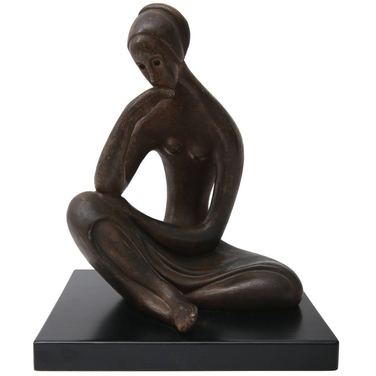 Sculpture of a Seated Female in Bronze Coloration