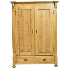 19th Century European Two-Door Pine Armoire with Drawers and Adjustable Shelving