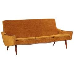Scandinavian Modern Orange Upholstered Sculpted Walnut Sofa, circa 1950s-1960s