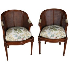 Pair of Antique French Louis XIV Style Carved Fruitwood and Caned Armchairs
