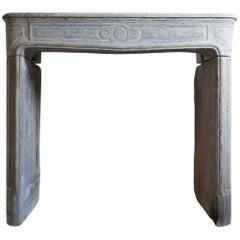 Louis XV Style Antique Limestone Fireplace, circa 19th Century