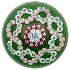 Clichy Interlaced Garland Paperweight on Translucent Green Ground