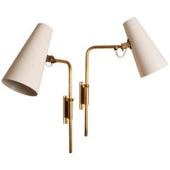 Paavo Tynell Pair of Adjustable Brass Sconces, Model 9459, 1940s