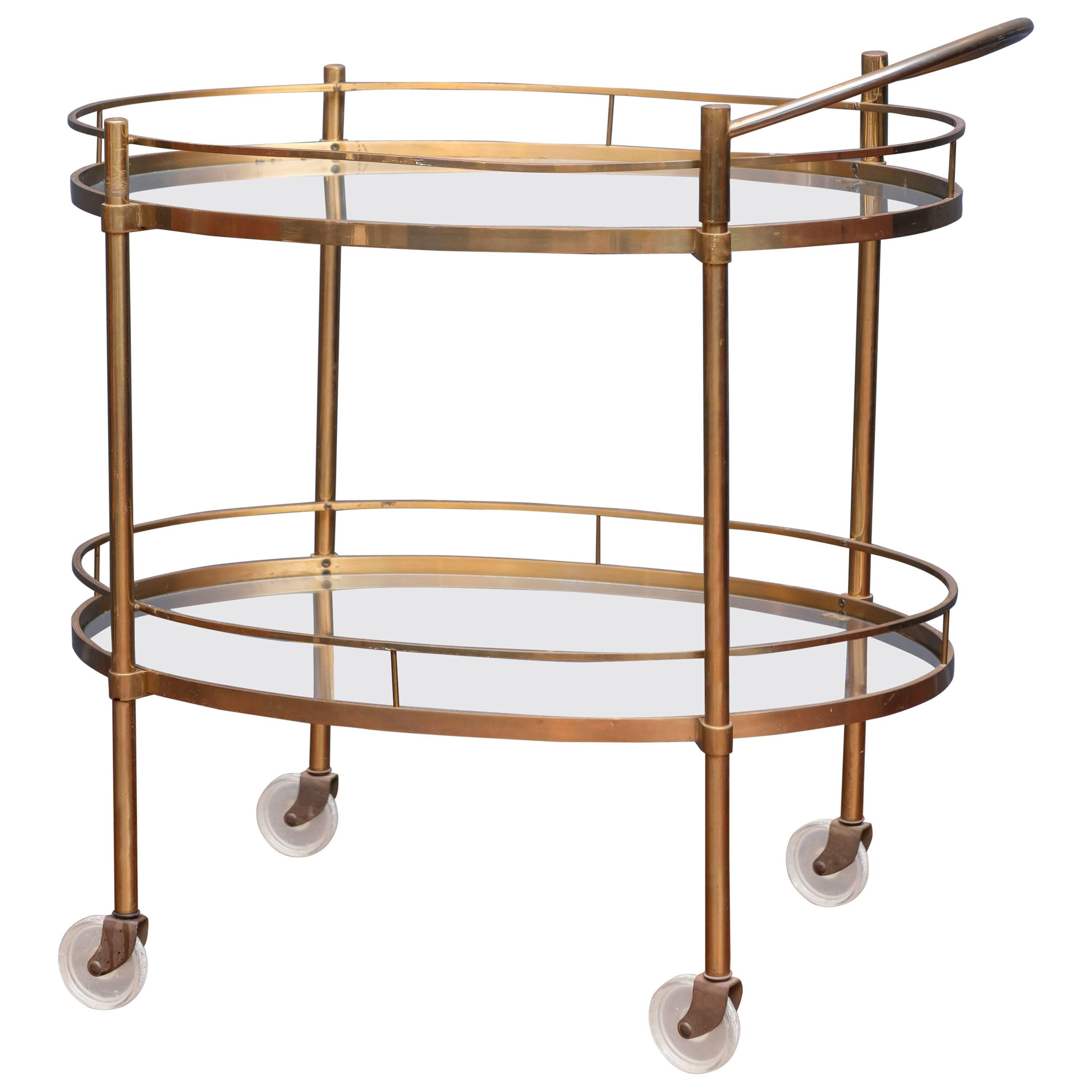 a midcentury hollywood regency brass bar cart with wine hold
