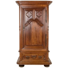 Rare 18th Century Louis XIII Hand-Carved Walnut Chateau Armoire or Bonnetiere