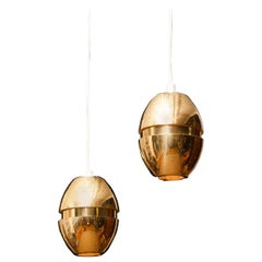 1950s, Pair of Brass Perforated Pendants by Hans-Agne Jakobsson