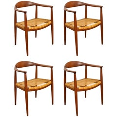 Set of Four Hans Wegner Round Chairs in Teak and Cane