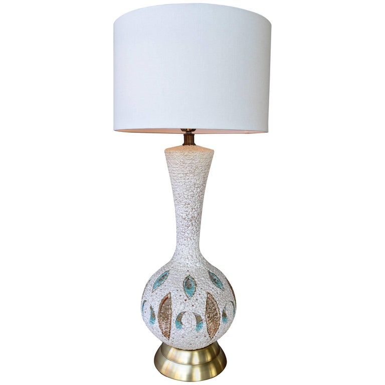 Mid-Century Modern Textured Ceramic Lamp with Leaf Cut-Outs and Lit Base For Sale