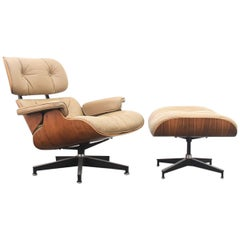Eames Lounge Chair and Ottoman in Rosewood and Caramel Coloured Leather, 1970s