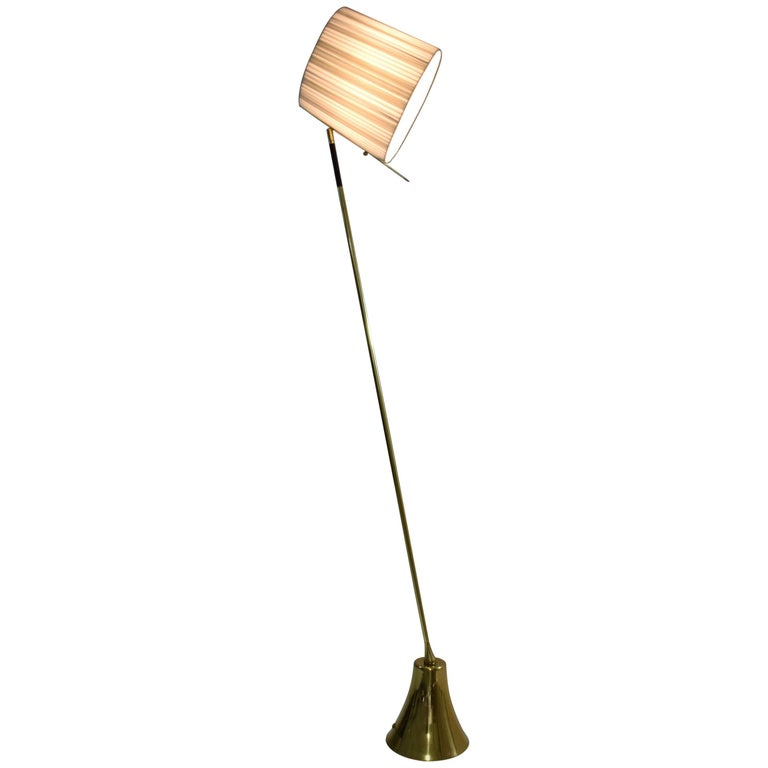 Equilibrium Definition: when opposite forces are in total harmony   Contemporary handcrafted floor lamp composed of a thick solid polished brass structure with a hand braided leather design, handcrafted by artisans saddlers, which rotates 360