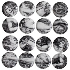 Two Complete Sets of Fornasetti Adam and Eve Coasters