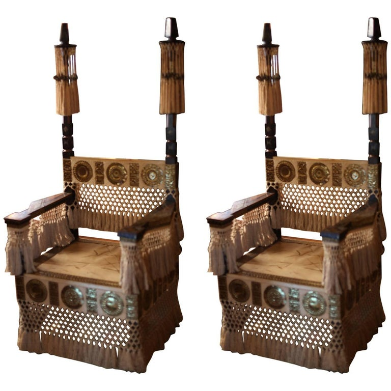 Pair of Carlo Bugatti throne armchairs, 1930s, offered by Ambianic