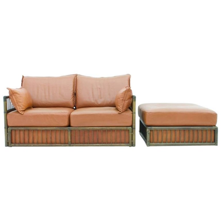 Two Person Leather Sofa and Foot Stool with Rattan For Sale