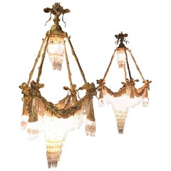 Pair of Doré Bronze Louis XVI Style Crystal Ribbon Tassle Drapery Chandeliers