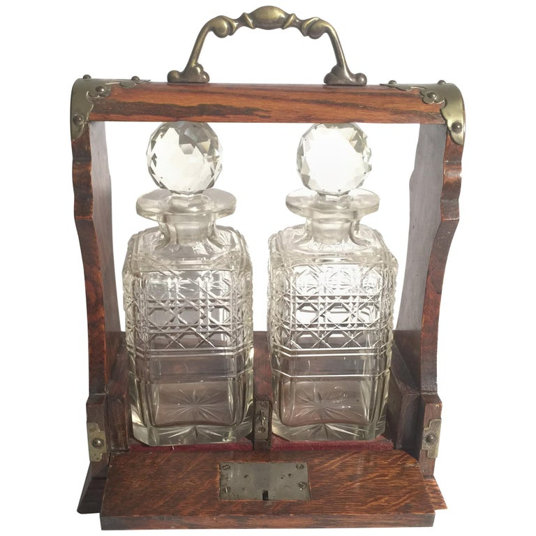 English Oak Tantalus with Two Cut Glass Decanters For Sale