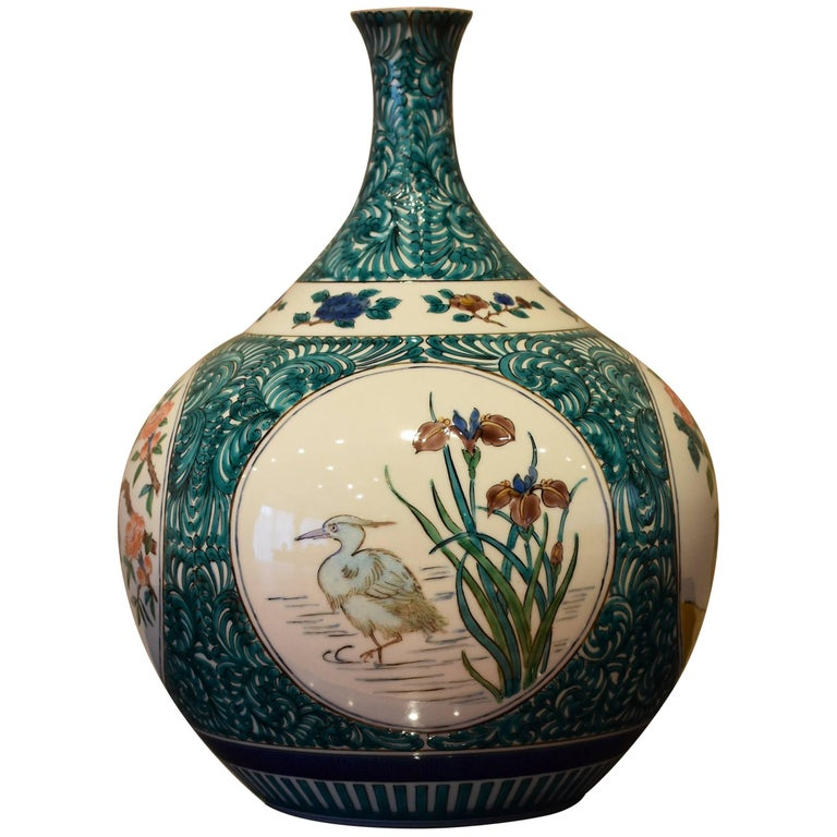 This exquisite Japanese one-of-a-kind Kutani porcelain vase, hand-painted on beautifully shaped porcelain body, is a signed masterpiece by Tamekichi the third, third generation master porcelain artist in traditional Kutani.  His grandfather, the