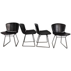 Harry Bertoia Black Metal Chairs with Black Leather Pads
