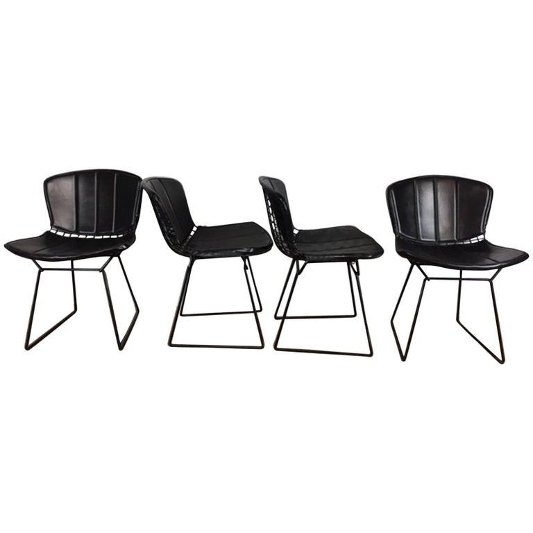 Harry Bertoia Black Metal Chairs with Black Leather Pads For Sale
