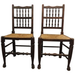 Pair of Antique English Country Harlequin Wood Chairs with Rush Seats