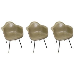 Three Eames Fiberglass Bucket Chairs