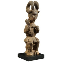 Igbo Tribal Seated Ikenga Figure with Sword and Head Africa, Nigeria
