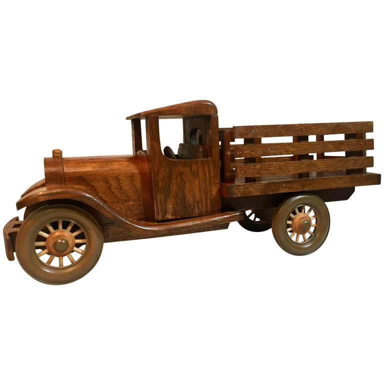 Signed Wooden Folk Art Truck with Removable Stakes