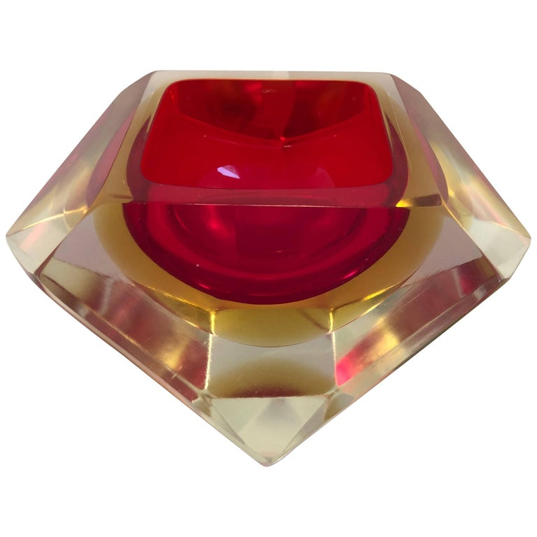Italian 20th century vintage Murano decorative geode sommerso bowl by Flavio Poli for Seguso Vetri d'Arte. Designed in a diamond shaped 12 faceted sides in hues of red and yellow. A luxurious piece of art glass to decorate any living space which can
