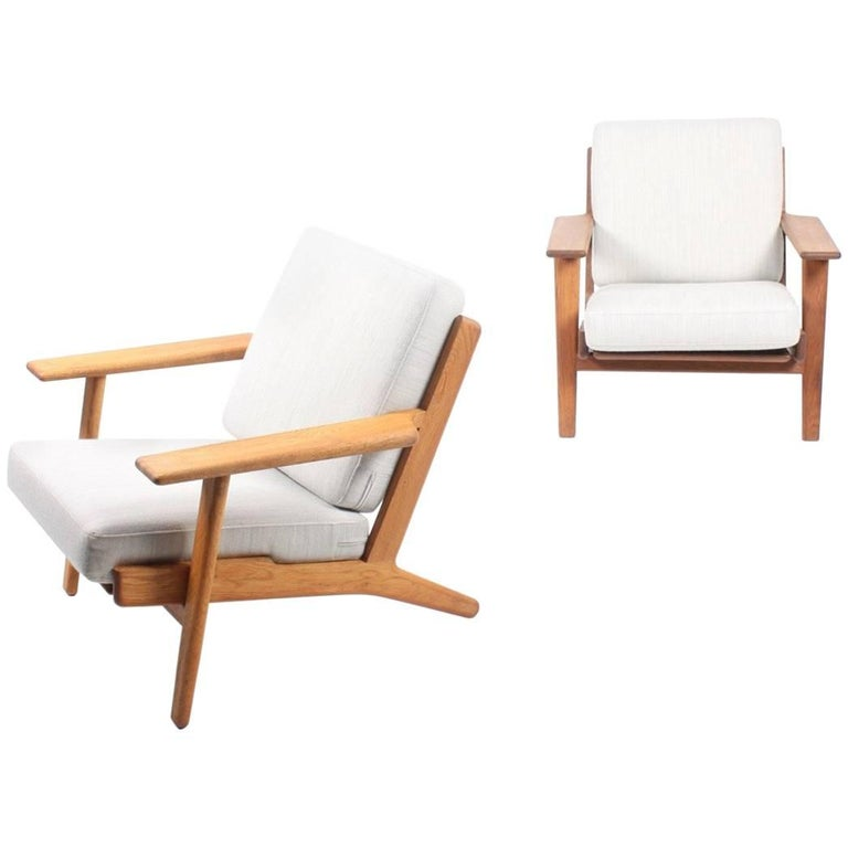 Pair of Classic Lounge Chairs by Wegner For Sale