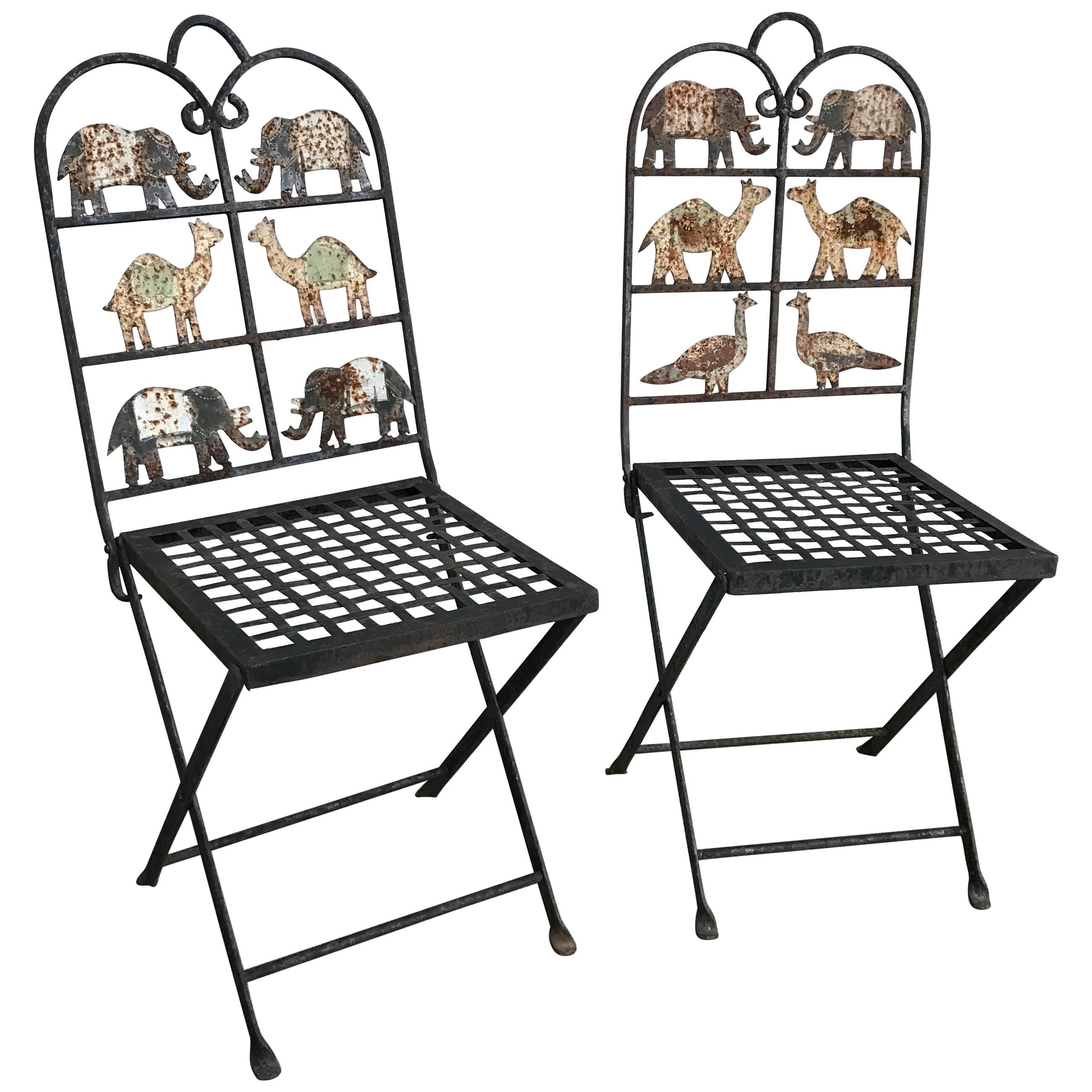 pair of wrought iron garden chairs with animals