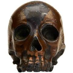 Japanese Meiji Lacquered Antimony Human Skull Okimono, 19th Century