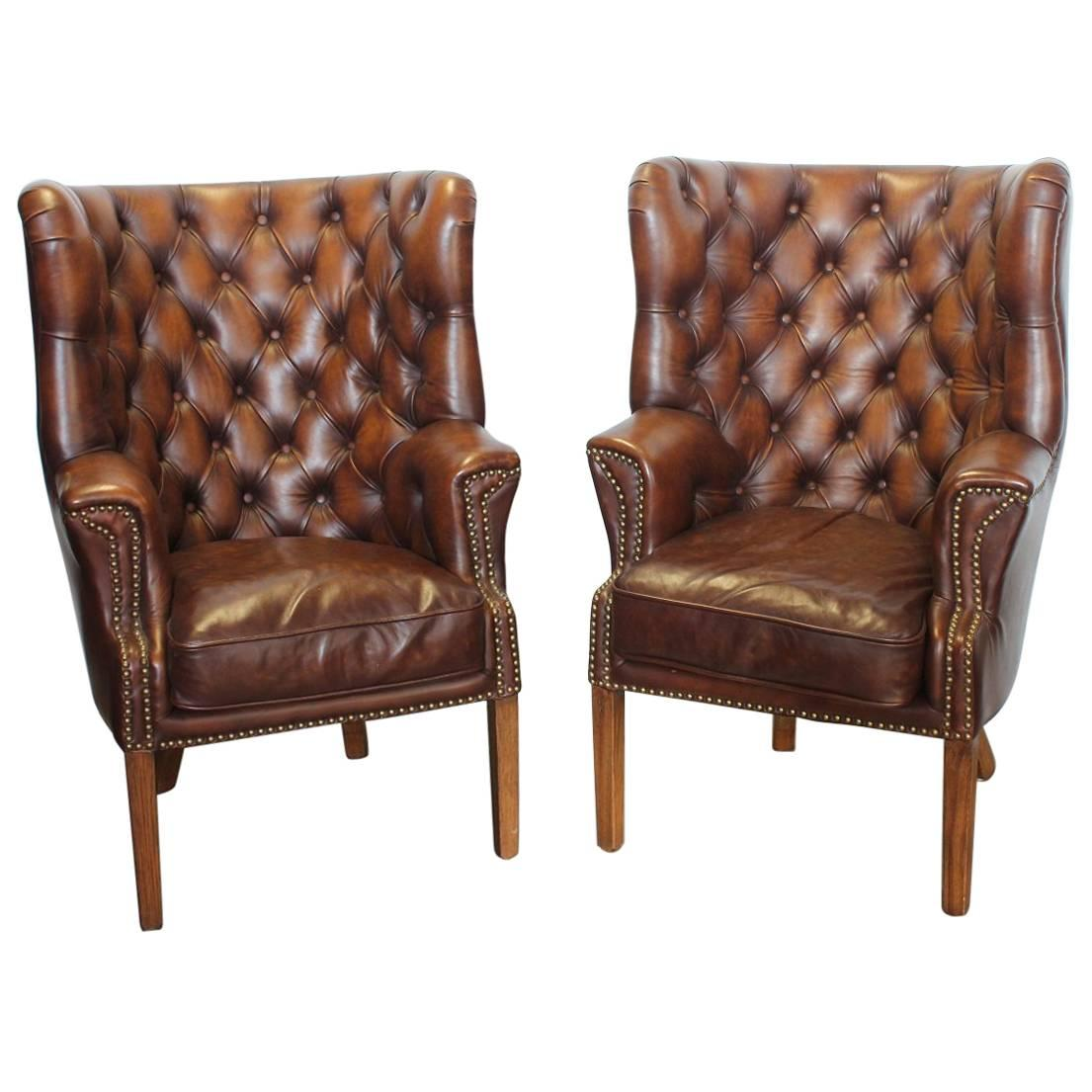 vintage tufted leather wing chairs